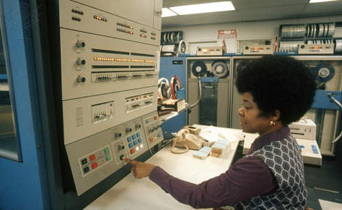 Woman Working on an Early Computer by Larry Mulvehill photo via ImageQuest